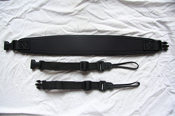 The OP/Tech strap comes in 3 pieces, the main pad that goes around your neck and two adjustable side straps with quick release buckles.